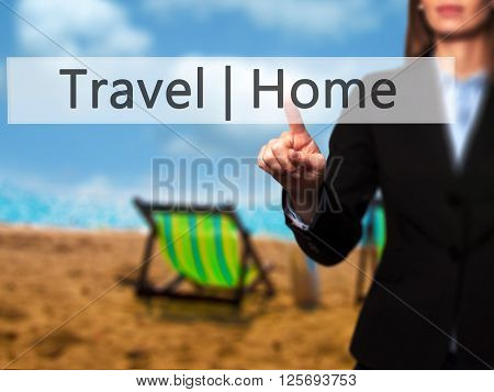 Travel  Home - Businesswoman Hand Pressing Button On Touch Screen Interface.