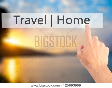Travel  Home - Hand Pressing A Button On Blurred Background Concept On Visual Screen.