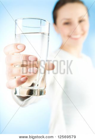Healthy Young Woman with glass of fresh Water