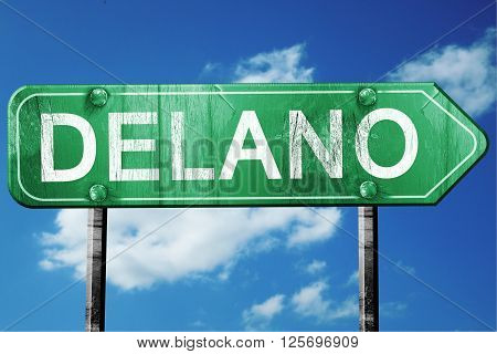 delano road sign on a blue sky background