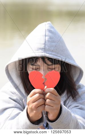 Sad Girl Praying to Reconcile with Red Broken Heart Shape