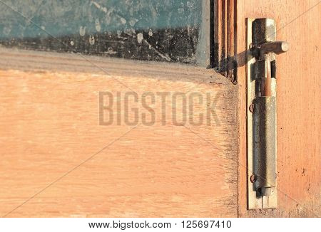 close-up old wooden window with Antique Iron window latch