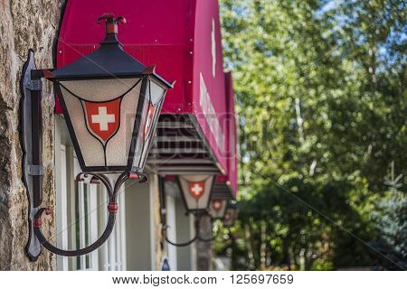 Vail, USA - September 10, 2015: Row of lanterns or lamps with Swiss Decoration and Logo on the buildings of Swiss Chalet restaurant in Vail, Colorado