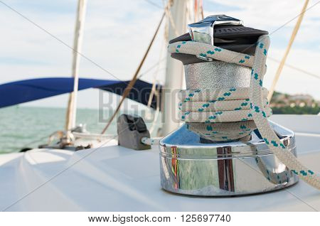 Sailboat Winch and Rope closeup Catamaran Yacht detail. Yachting Phuket Thailand