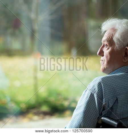 Disabled man suffering from loneliness in old age