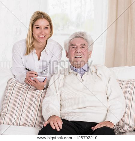 Female Caregiver And Senior Man