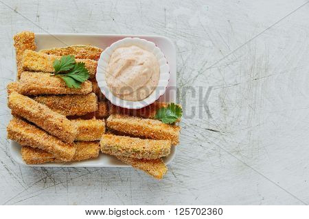 Fried zucchini breaded cheese and white sauce