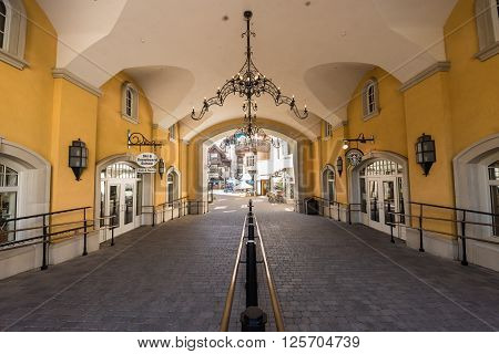 Vail, USA - September 10, 2015: Arched Pathway with railing to the shopping area at Lionshead Place in Vail, Colorado, USA.