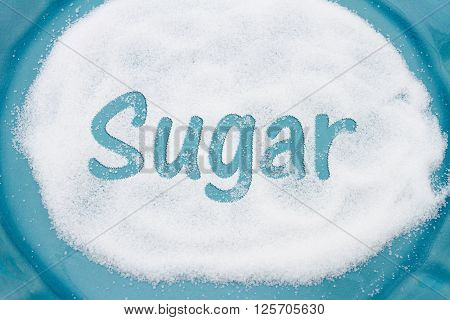 Close-up of Teal Plate with a lot of sugar with text Sugar