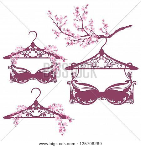 spring season lingerie design set - hangers and bras among blooming branches vector collection