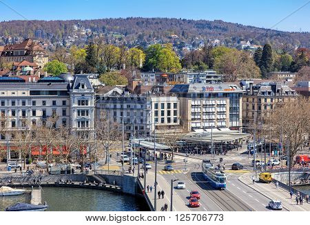 Zurich, Switzerland - 11 April, 2016: pedestrians and traffic on Quaibruecke bridge and Bellevue square view from the Ferris wheel temporarily installed on Burkliplatz square. Zurich is the largest city in Switzerland.