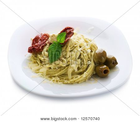Italian Pasta with Pesto sauce,dried tomato,olives,basil and Parmesan cheese.