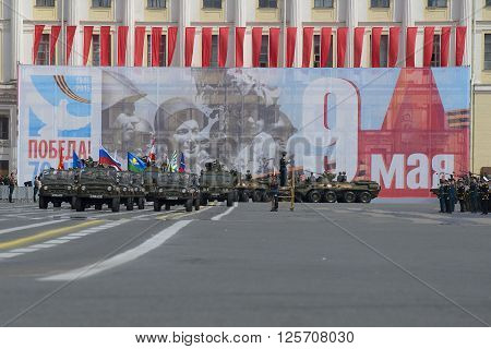 ST. PETERSBURG, RUSSIA - MAY 05, 2015: Group with banners on cars UAZ-469 at the head of a column of military equipment. Rehearsal of parade in honor of Victory Day in St. Petersburg