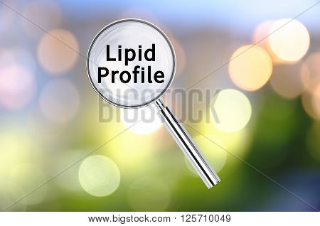 Magnifying lens over background with text Lipid Profile, with the blurred lights visible in the background.