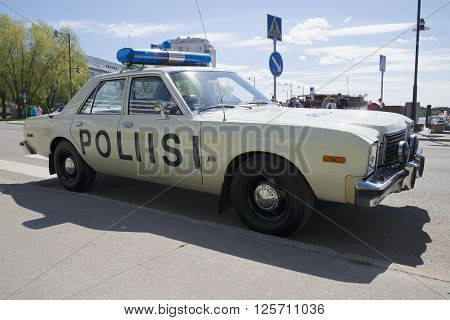 SAVONLINNA, FINLAND - JUNE 06, 2015: Police car Dodge Aspen conducts patrols on the streets of Savonlinna