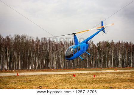 The aircraft - the small blue helicopter at competitions makes flight at low height.