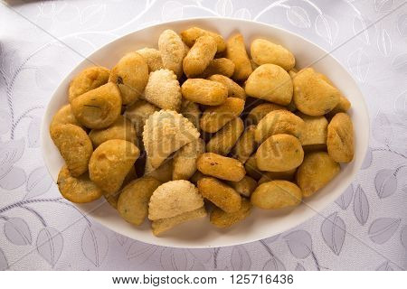 Mixed brazilian snack served on the table.