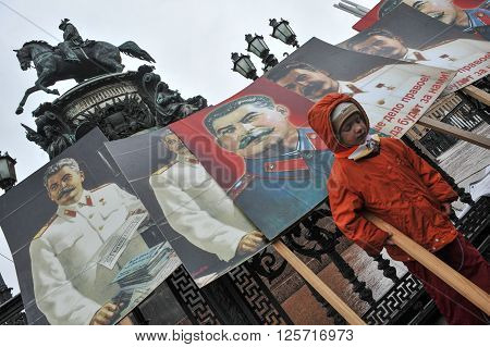 ST. PETERSBURG RUSSIA - MAY 1: Portraits of Russian dictator Joseph Stalin at the fence of the monument to the Russian Tsar Nicholas 1 during a May Day demonstration in May 1 2010