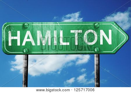 hamilton road sign on a blue sky background