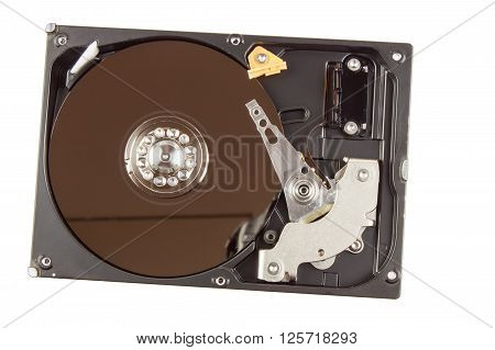 Open hard drive on a white background. Production of computers. Electronics store. Backing up data on your computer. Modern technology. Place for your text.