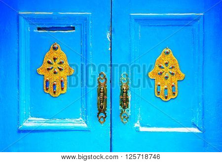 The doors made of wood painted blue. Decoration concept