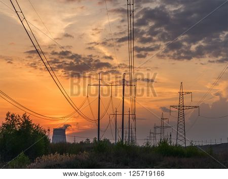 Power line of a nuclear power station sunset