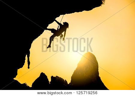 The rock-climber during rock conquest. Extreme sport concept