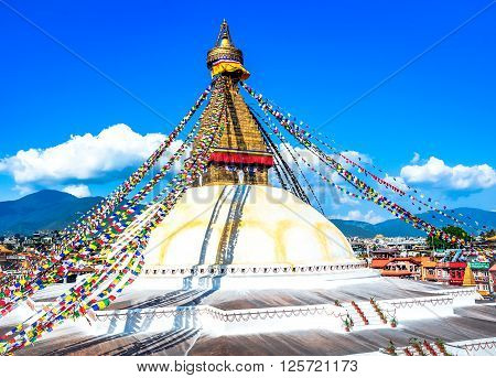 Bodhnath stupa in kathmandu with buddha eyes and prayer flags