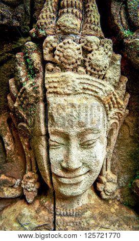 Ancient bas-relief at the facade of Angkor Wat  in Angkor, Cambodia.