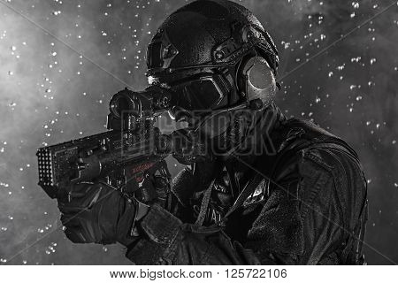 Spec ops police officer SWAT in the rain