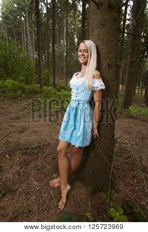 blonde woman in a bavarian dirndl outdoor