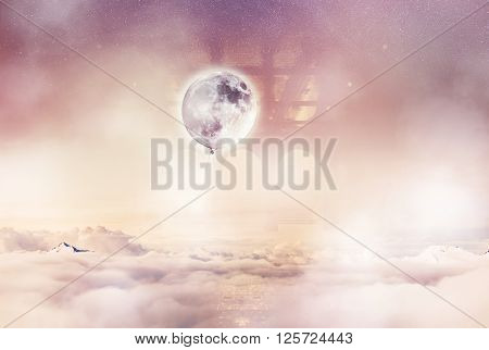 Imaginary World. Balloon moon above the clouds.