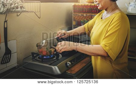Mother Cooking Soup Kitchen Concept
