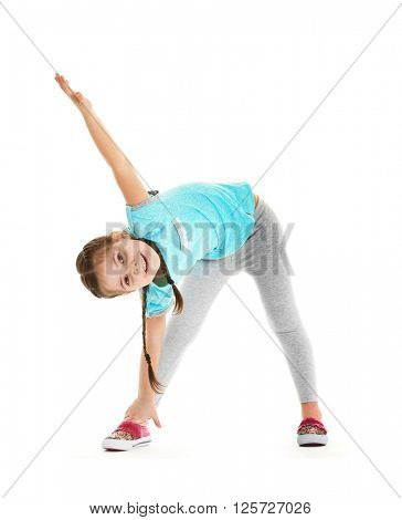 Little cute girl stretching herself, isolated on white