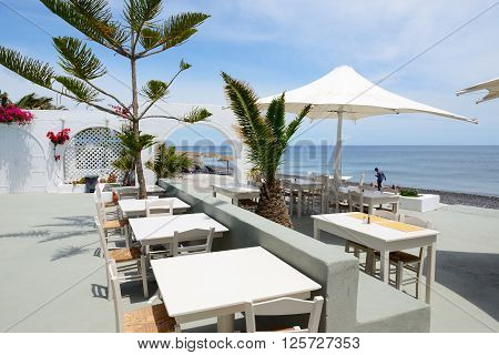 The outdoor restaurant near beach Santorini island Greece