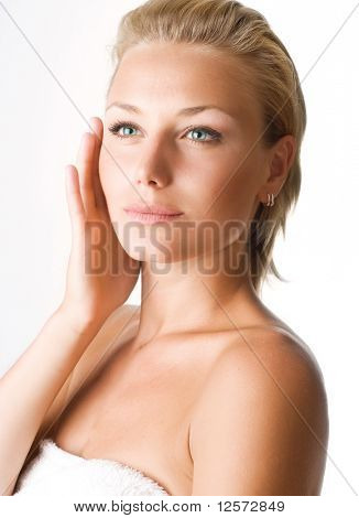 Beautiful Young Woman touching her face.Perfect skin
