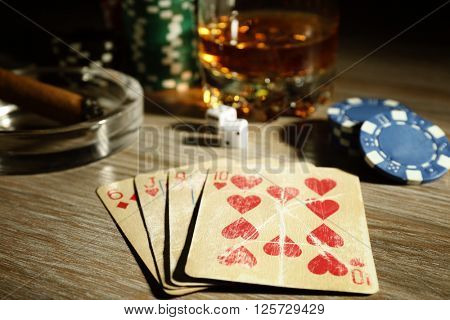 Set to playing poker with cards and chips on wooden background