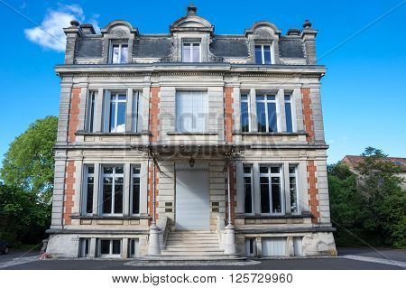 COGNAC, FRANCE - MAY 06, 2015: Old house in french town Cognac. The town gives its name to one of the world's best-known types of brandy