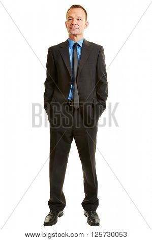 Isolated full body businessman standing and looking pensive in a suit