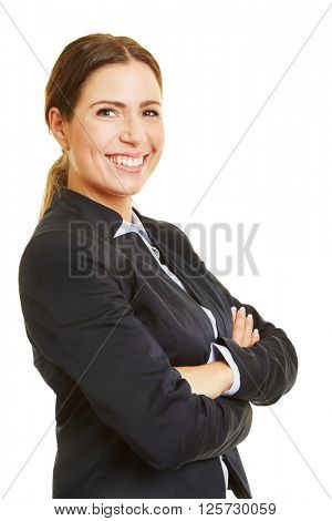 Smiling businesswoman from the side with her arms crossed