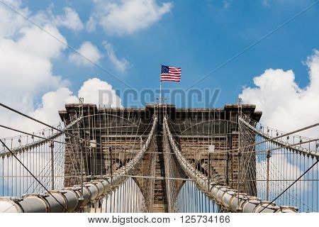 The Brooklyn Bridge is a bridge in New York City and is one of the oldest suspension bridges in the United States. Completed in 1883 it connects the boroughs of Manhattan and Brooklyn by spanning the East River.