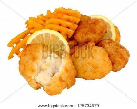 Fried batter coated cod fish nuggets with lattice potato fries isolated on a white background