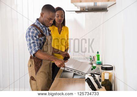 Serviceman Repairing Stove