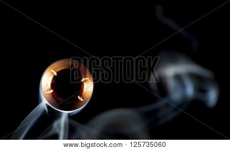 Hollow point bullet with smoke that looks like it is coming close