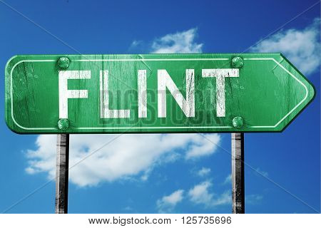 flint road sign on a blue sky background