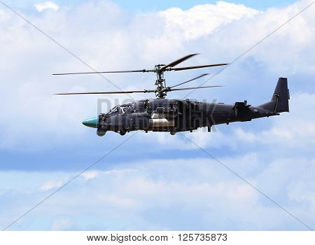 MOSCOW REGION  -   JUNE 10: Modern russian attack helicopter Ka-52 with rockets bombs guns  -  on June 10, 2015 in Moscow region