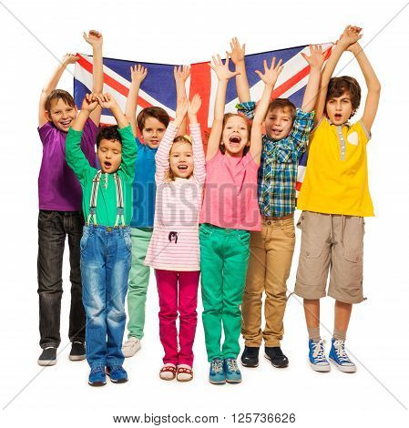 Group of seven happy kids raising their hands up with English flag, isolated on white background
