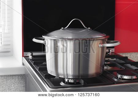 stainless saucepan on a gas stove in the kitchen