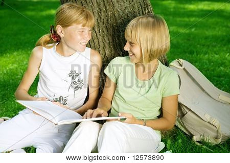 Two School Girls Reading the Book outdoor