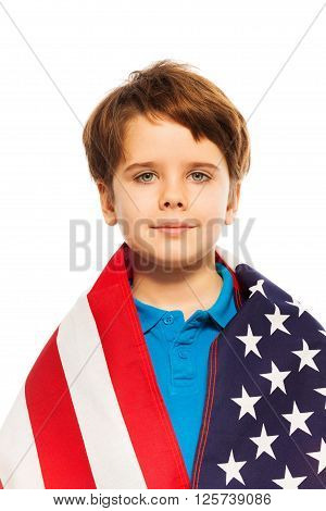 Close-up portrait of little boy wrapped in the USA flag, isolated on white background